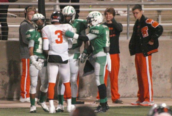 Brenham players show Cubs Class as they console a Texas City player. (Courtesy: Dr. Robert Stark)