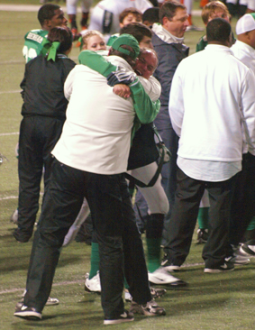 Coaches Craig Agnew and Tim Oehrlein embrace after the final gun. (Courtesy: Dr. Robert Stark)