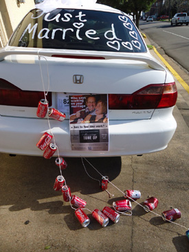 A car decorated for a wedding sits in front of First Baptist Chruch