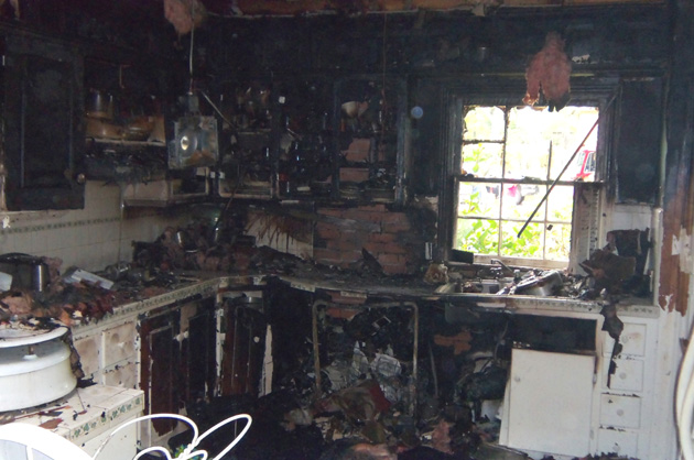 The fire caused heavy smoke and fire damage to the kitchen.