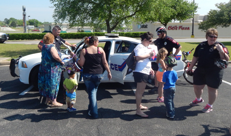 The Brneham Police Department let the youngsters check out one of their cruisers.