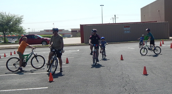 Young bike riders learn the finer points of handling a bicycle.