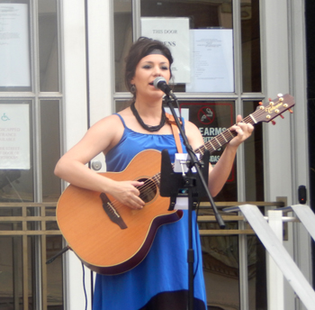 "Local artist Amanda Randermann treats the crowd to an emotional perfromance of ""Concrete Angel"""
