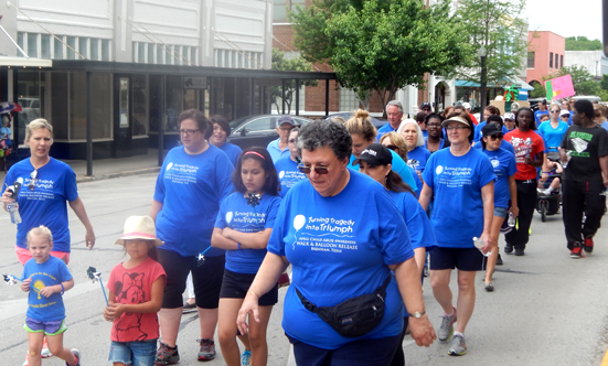 The walkers begin their two-mile trek headed east on Alamo Street.