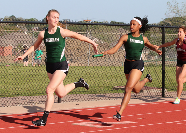 Angel Darcus hands off to Ashley Homan in the 4X100.