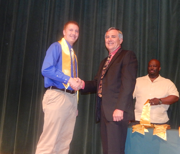 Jeremy Arnold, shaking hands with principal Steve Skrla, looks forward to a career in law enforcement.
