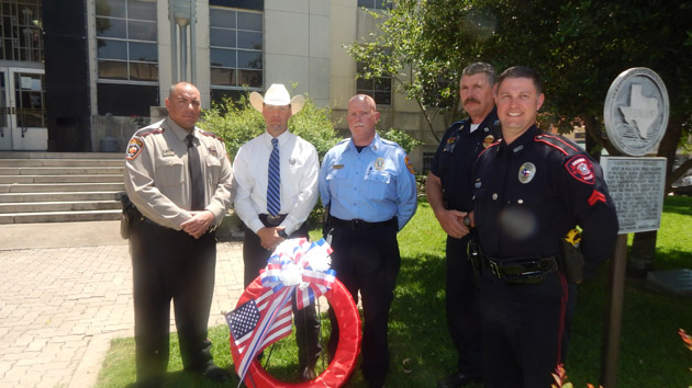 Washington County Peace officers lay a wreath at the Courthouse to remember fallen peace officers.