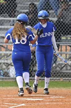 Carly Latta (18) receives congratulations from Delilah Pacheco.