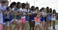 The Buccaneer Dance team and Cheerleaders get their National Championship rings.