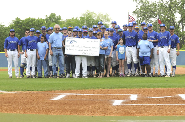 The Blinn Baseball team and Adams Angels celebrate over $1200 in donations to the local program.