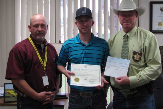 Pictured Left to Right:  Brad Murray, Ty Murray and Sheriff Jack Brandes