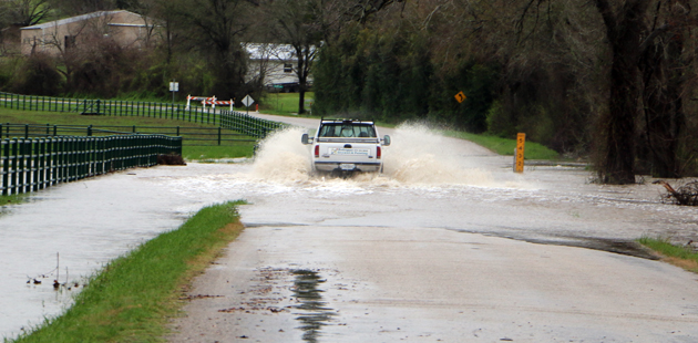 Truck flooding road