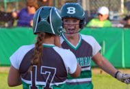 Kat Marshall congratulates Brette Kohring after scoring a first-inning run. (Mark Whitehead)