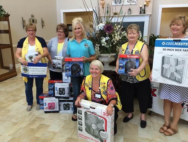 Members of the Washington Co. Ladies Lions Club helped collect fans for the elderly.