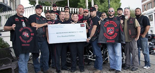 "Brenham Police Department receives its donation– Chief Craig Goodman and Officer Ashley Burns accepted the check from Los Carnales President, James ""Gump"" Reaves."