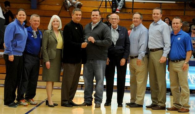 Coach Scott Schumacher is honored prior to Wednesday's game. (Jake Gordon)