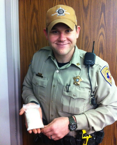 Deputy Louis Gabler, with the methamphetamie he confiscated in his arrest.