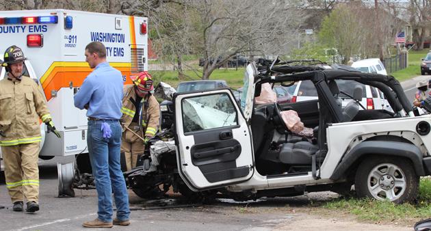 Emergency crews help the injured woman.