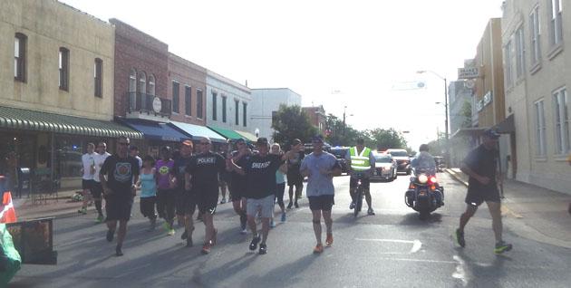 Washington County Sheriff Otto Hanak carried the Special Olympics Torch Run through Brenham.