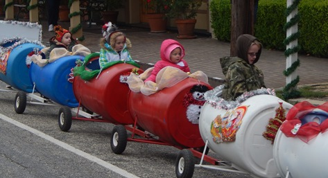 Youngsters take a chilly ride on the Barrell Train.