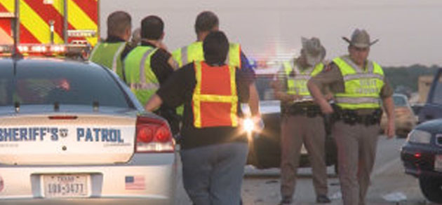 Law enforcement officers at the scene of the highway fatality.  (photo courtesy KBTX.)