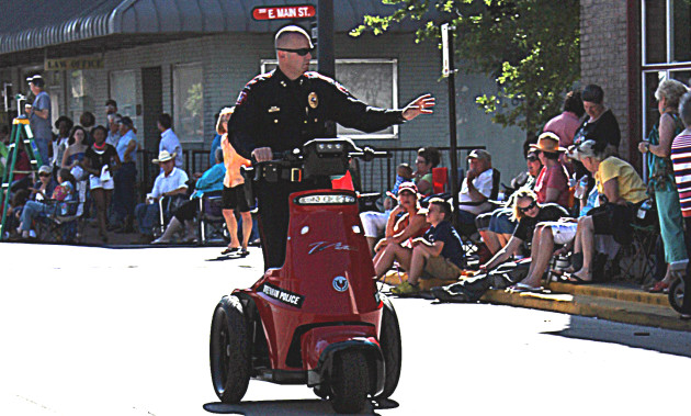 Brenham police chief Rex Phelps shows off the new three wheel police vehicle during the Maifest Parade.