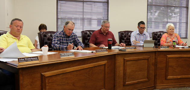 Photo of COMMISSIONERS PRESENT PLAQUE TO MAY FAMILY DURING TUESDAY MEETING