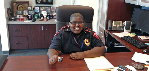 Traelan Nickerson gets comfortable at the police chief's desk.
