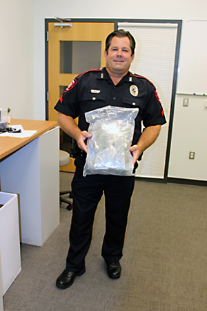 Cpl. Tommy Kurie displays the confiscated marijuana.