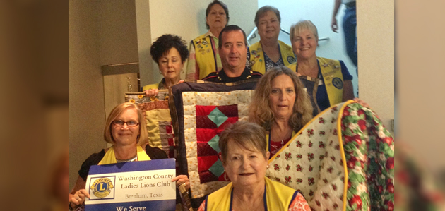Photo of LADY LIONS DONATE BLANKETS TO BRENHAM POLICE DEPARTMENT