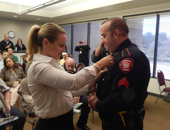 Justin Schiller receives his pin for his promotion