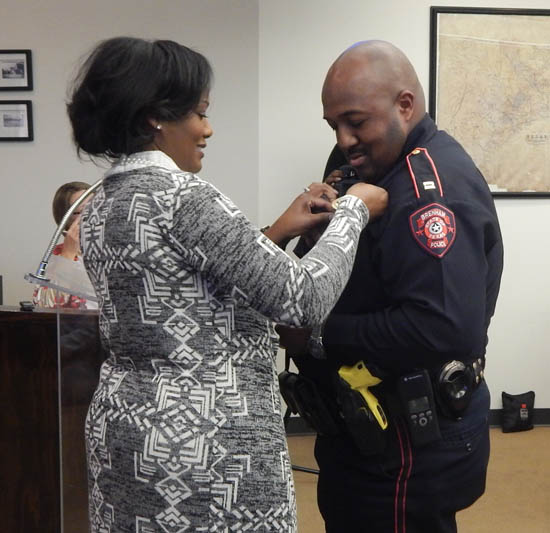 Lloyd Powell receives his promotion to Administrative Captain