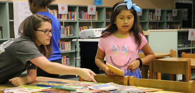 Photo of BHS HISTORY CLUB STUDENTS DELIVER BOOKS TO ELEMENTARY SCHOOLS
