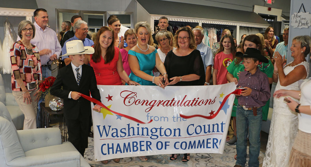 a3b6e351f3630 Robin Wagner (in blue) and Linda Grimm cut the ribbon at Bustles and Bow  Ties Boutique.