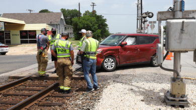 Photo of NOON TIME WRECK STRANDS VEHICLE ON RAILROAD TRACKS
